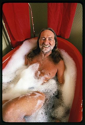 Harry Benson ,   Willie Nelson in the Bath, Edition of 35  ,  1983     photograph     HB120441
