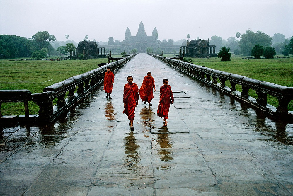 Steve McCurry ,   Monks in the Rain  ,  2011     FujiFlex Crystal Archive Print     CAMBODIA-10089