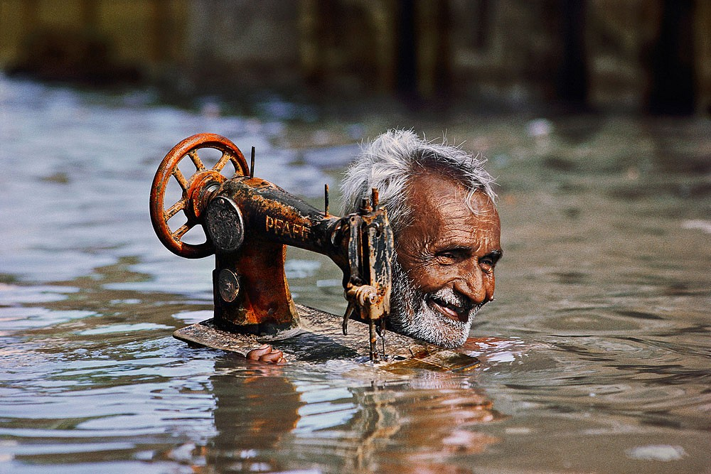 Steve McCurry ,   Man with Sewing Machine  ,  1983     FujiFlex Crystal Archive Print ,  (Inquire for sizes)     INDIA-10004NF