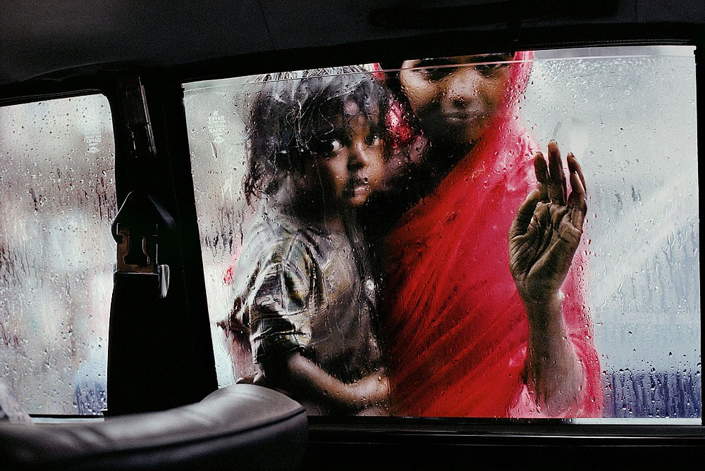 Steve McCurry ,   Mother and Child at Car Window  ,  1993     FujiFlex Crystal Archive Print ,  20 x 24 in.     INDIA-10214