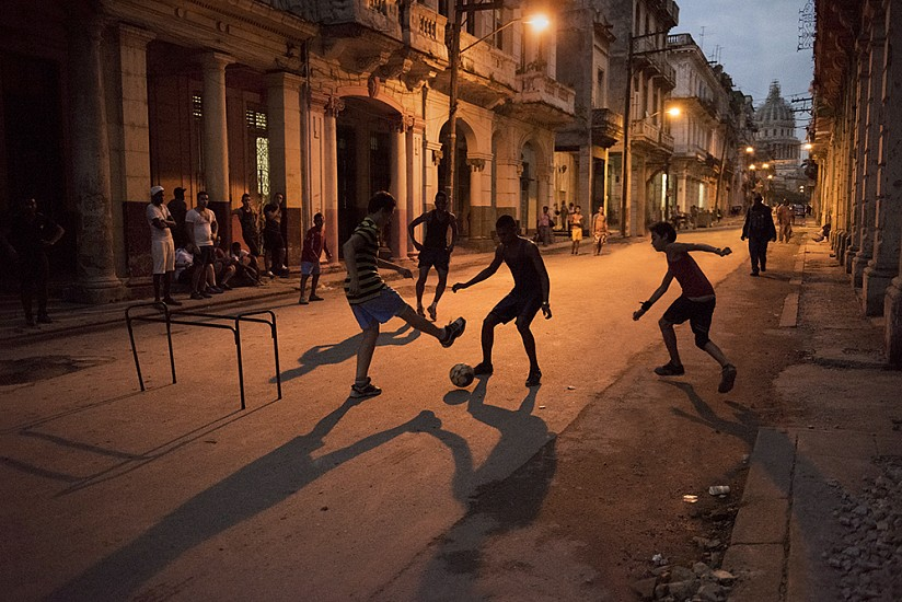Steve McCurry, Children Play a Game of Soccer in the Street 2014, FujiFlex Crystal Archive Print