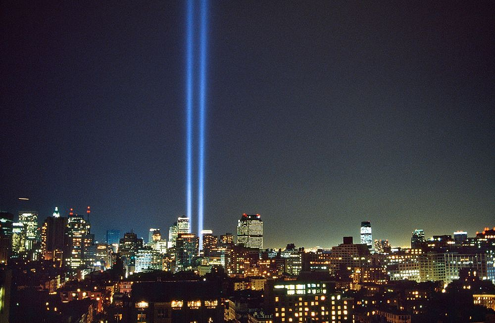 Steve McCurry ,   Beams of Light Mark Where the World Trade Center Stood, New York, NY  ,  2002     FujiFlex Crystal Archive Print ,  30 x 40 in. (Inquire for additional sizes)     USA-10814