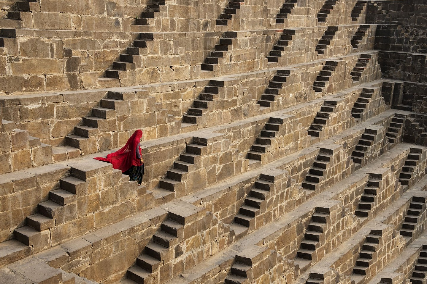 Steve McCurry ,   Woman in Chand Baori Stepwell, Abhaneri, India  ,  2016     FujiFlex Crystal Archive Print ,  30 x 40 in.     INDIA-13113